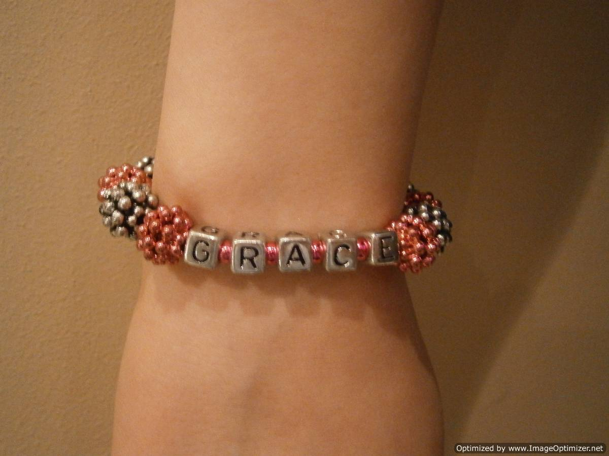 Full Circle Jewellery Making Girls Parties - elasticated berry bracelet made by Grace during a girl's party